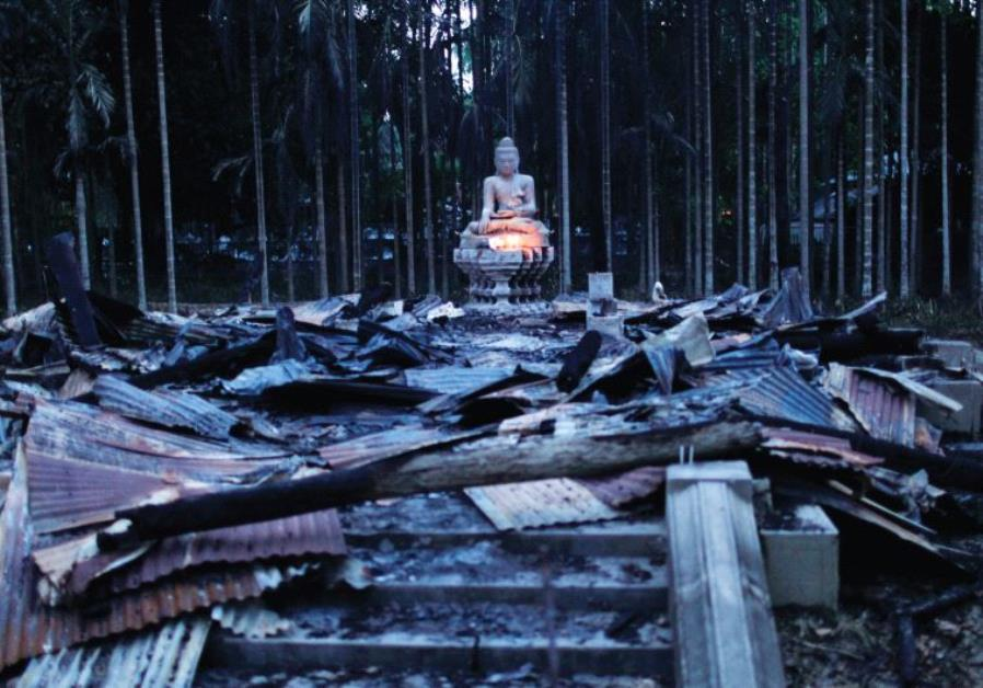 A BUDDHA sculpture sits atop wreckage after an attack against a Buddhist temple in Cox's Bazar, Bang