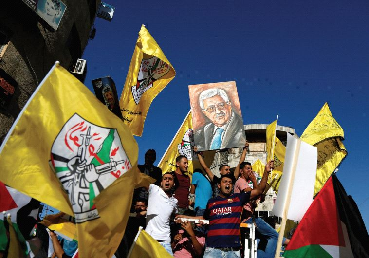 PALESTINIANS PARTICIPATE in a recent rally to support Palestinian President Mahmoud Abbas in Ramalla