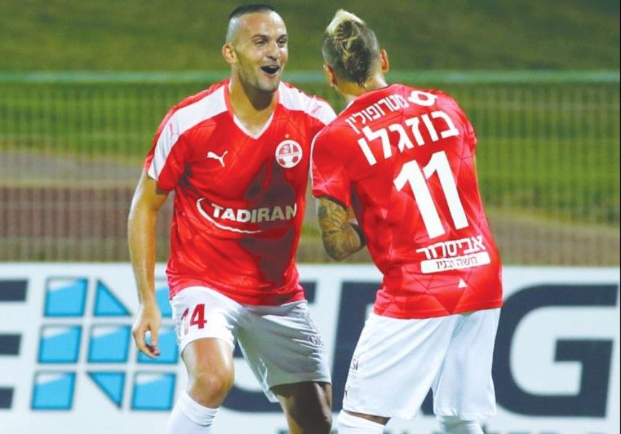 Hapoel Beersheba striker Ben Sahar (left) celebrates with teammate Maor Buzaglo after scoring his se