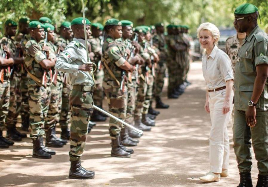 GERMAN DEFENSE MINISTER Ursula von der Leyen is received with a guard of honor of Malian soldiers as