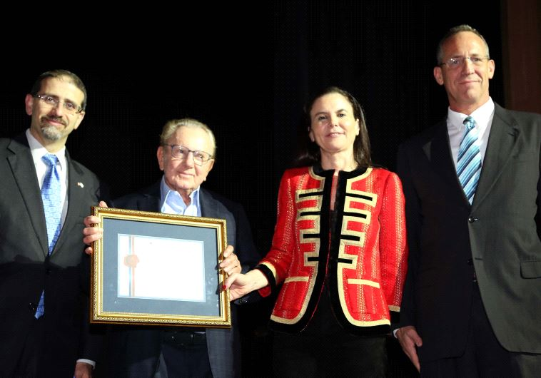 MORRIS KAHN (second left) receives the America-Israel Chamber of Commerce Lifetime Achievement Award