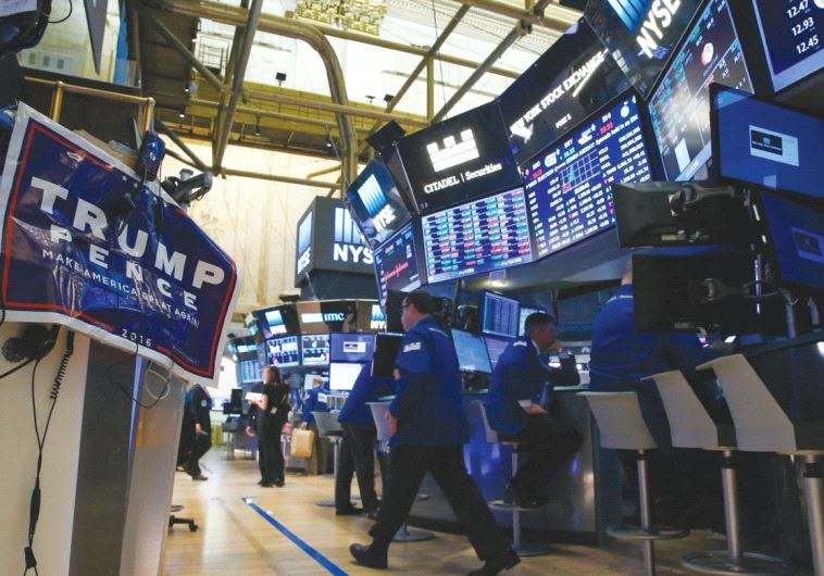 A TRUMP poster is displayed on the floor of the New York Stock Exchange