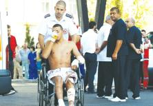 AN ISRAELI SURVIVOR of the Hezbollah bombing at Burgas, Bulgaria, on July 19, 2012, is wheeled to a