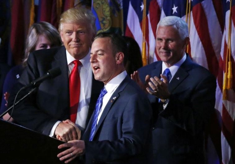 US President elect Donald Trump shakes hands with Republican National Committee Chairman Reince Pr