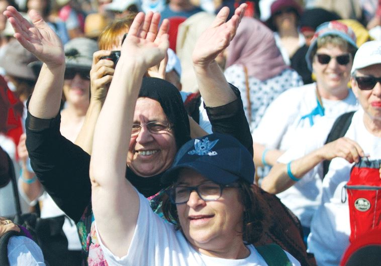 ISRAELIS AND PALESTINIANS rally in support of peace near Jericho on October 19.