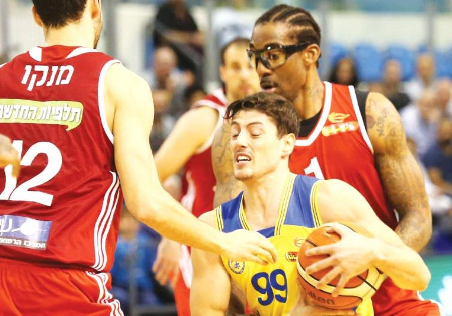 Maccabi Ashdod guard Yiftach Ziv (99) had 15 points, six rebounds and five assists in last night's 7