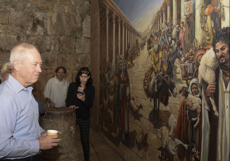 Housing and Construction Minister Yoav Galant (center) tours the Cardo section of the Jewish Quarter