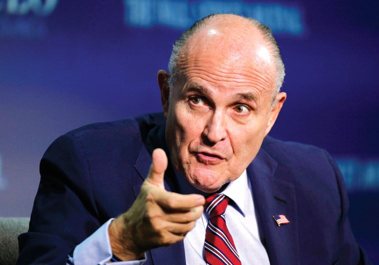 RUDY GIULIANI, vice chairman of the Trump Presidential Transition Team, speaks at the Wall Street Jo
