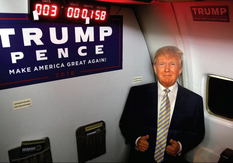 A CARDBOARD cutout of Donald Trump is pictured on a media charter plane with a countdown clock to th