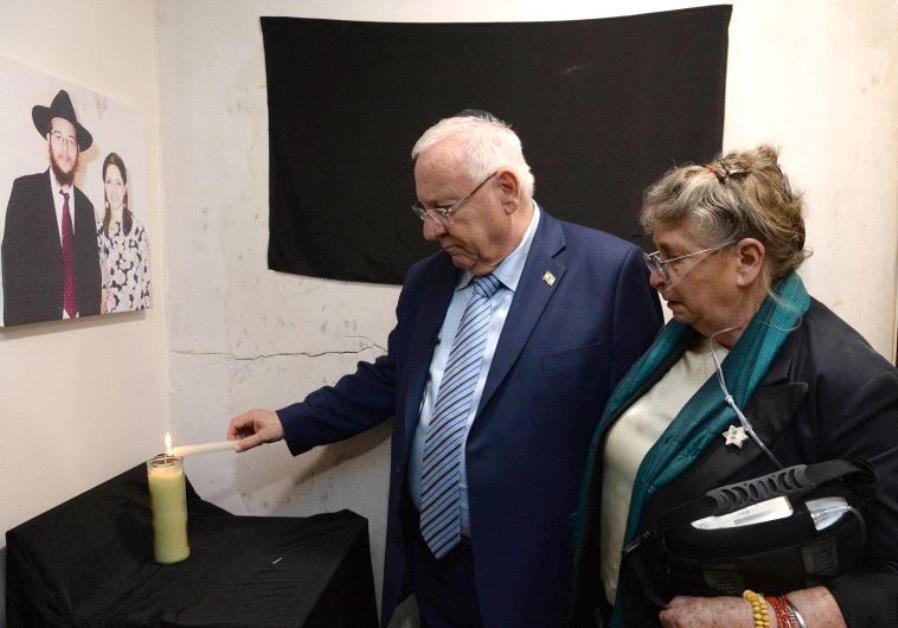 Rivin lights memorial candle at Mumbi Chabad House