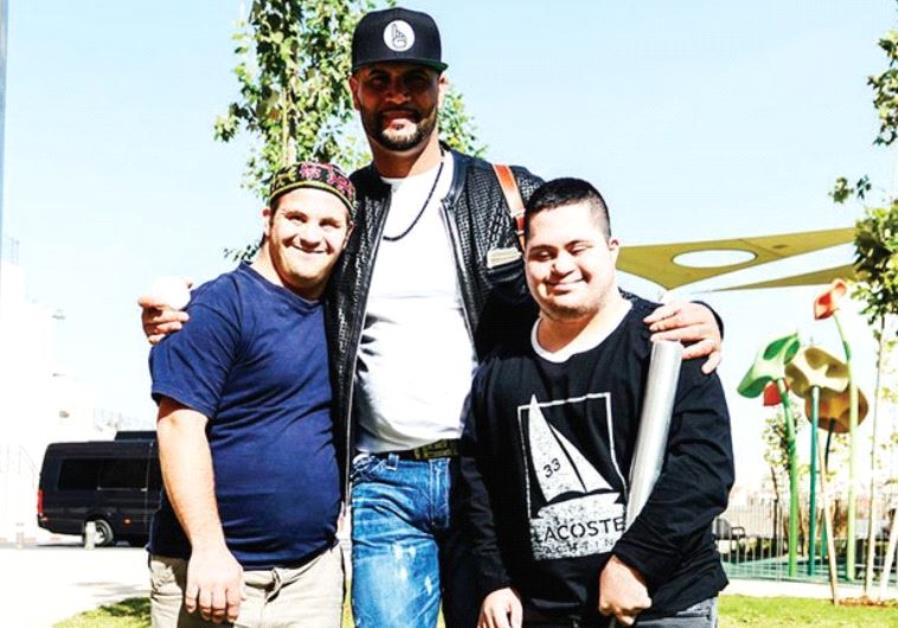 MAJOR LEAGUE BASEBALL superstar Albert Pujols (center), of the Los Angeles Angels, visited Shalva's