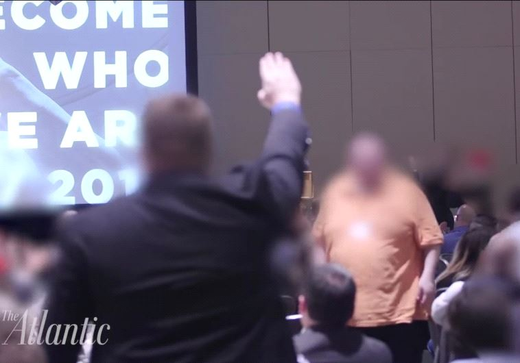 A supporter of the alt-Right giving a Nazi salute.