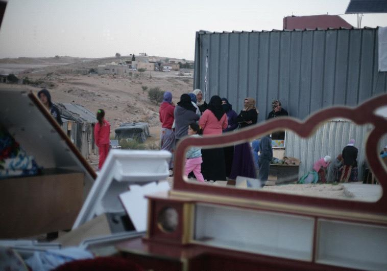 Family gathered around their house which was slated for demolition on Tuesday