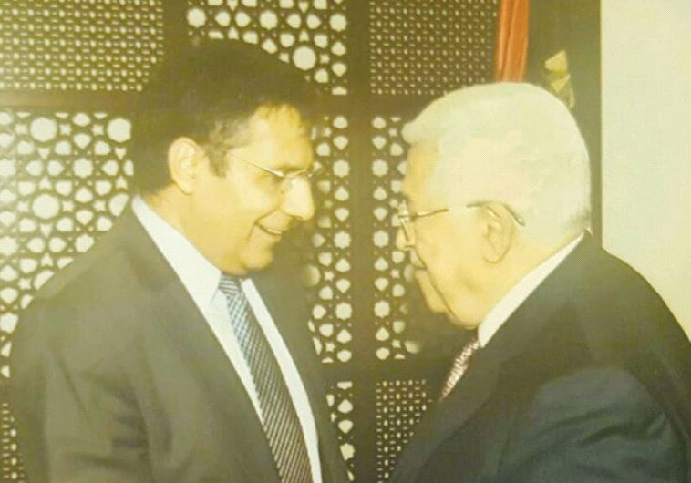 ZIONIST UNION MK Yossi Yonah (left) and PA President Mahmoud Abbas shake hands at the Mukata preside