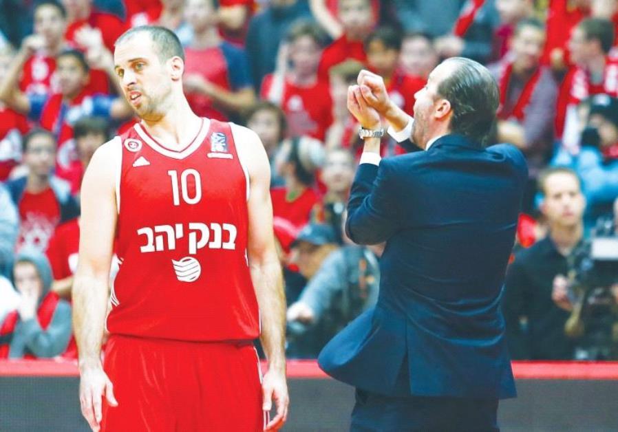 Hapoel Jerusalem guard Yotam Halperin (left) and coach Simone Pianigiani