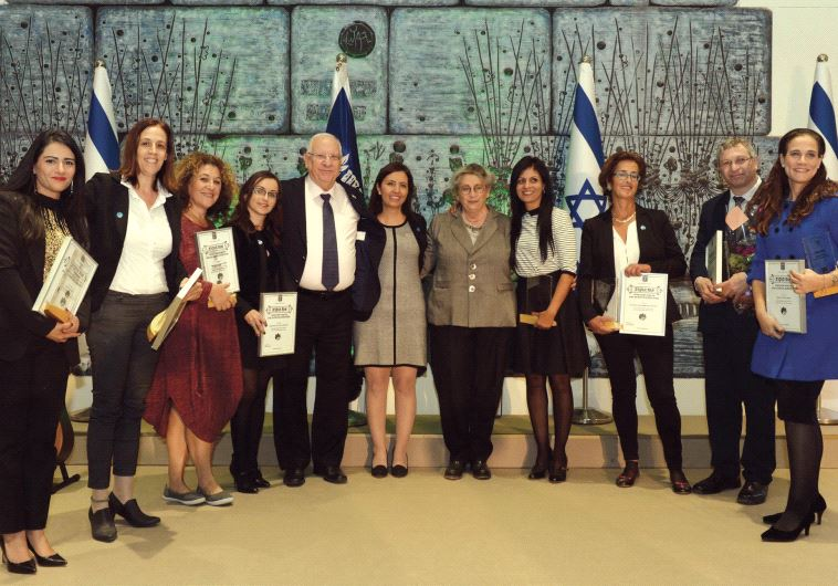 PRESIDENT REUVEN RIVLIN his wife, Nechama, flank Social Equality Minister Gila Gamliel yesterday at
