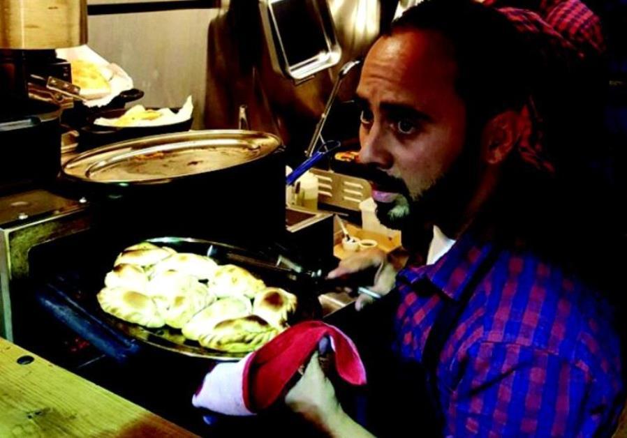 Argento chef Lucas Zitrinovich prepares an empanada