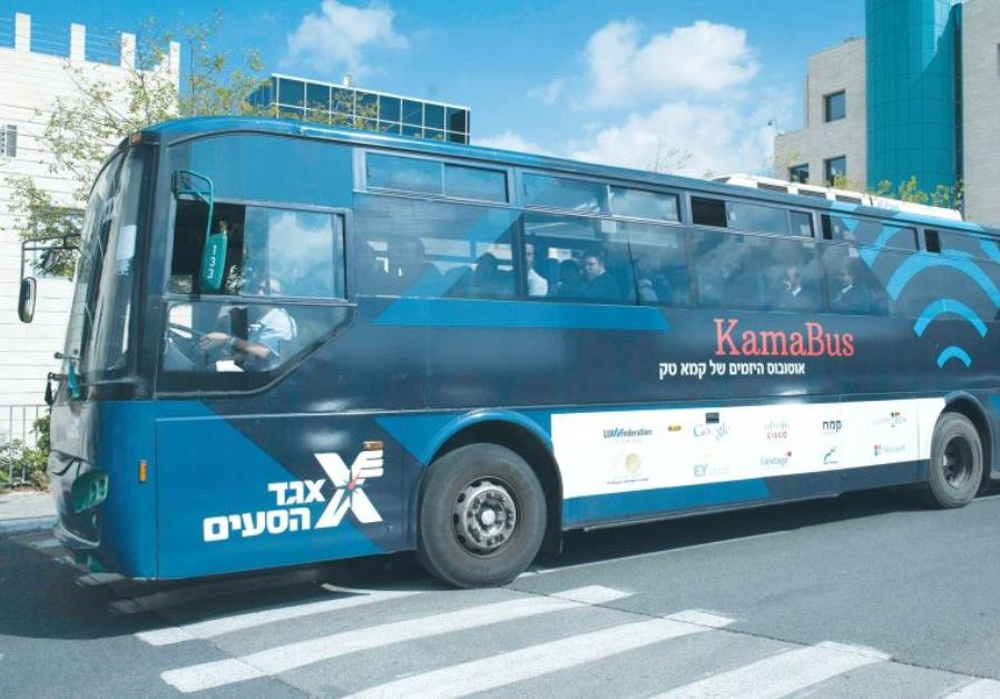 ULTRA-ORTHODOX participants take a ride last week on KamaTech's entrepreneur bus. Their trip took th