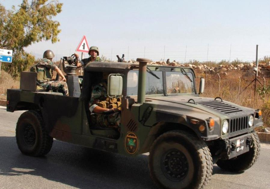 LEBANESE SOLDIERS drive near the border with Israel in Kafr Kila, in October. Israel has used its ab