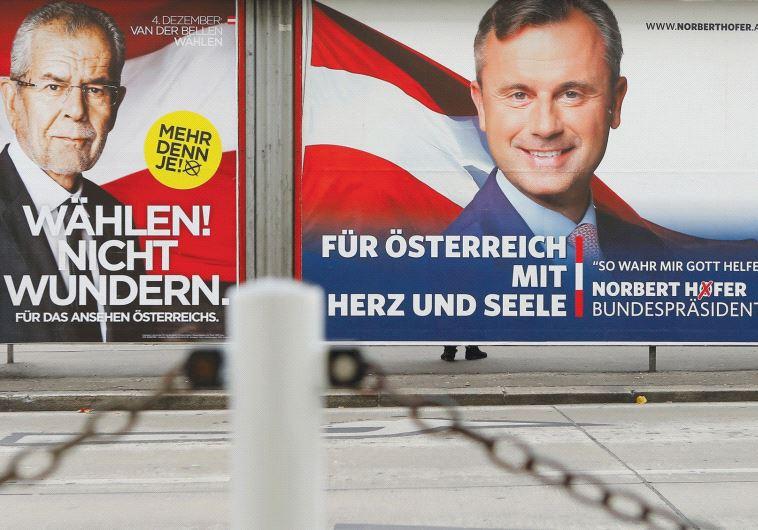 PRESIDENTIAL ELECTION campaign posters of Alexander Van der Bellen (left) and Norbert Hofer are seen