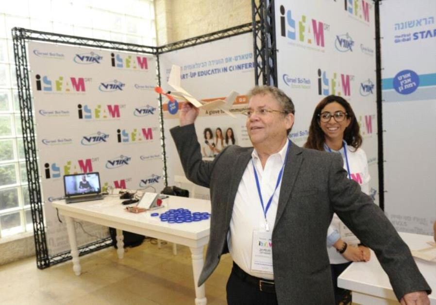 Zvi Peleg, director general of ORT Israel playing with ORT Ramat Gan's projects during the summit.