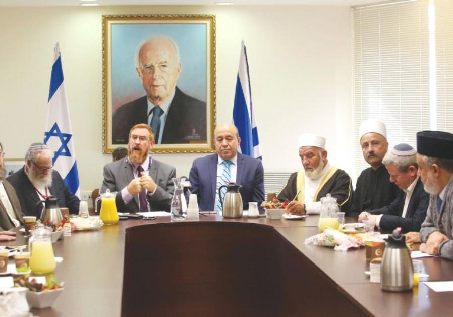 MKS YEHUDAH GLICK (rear left) and Zuheir Bahloul lead a conference at the Knesset yesterday, which w