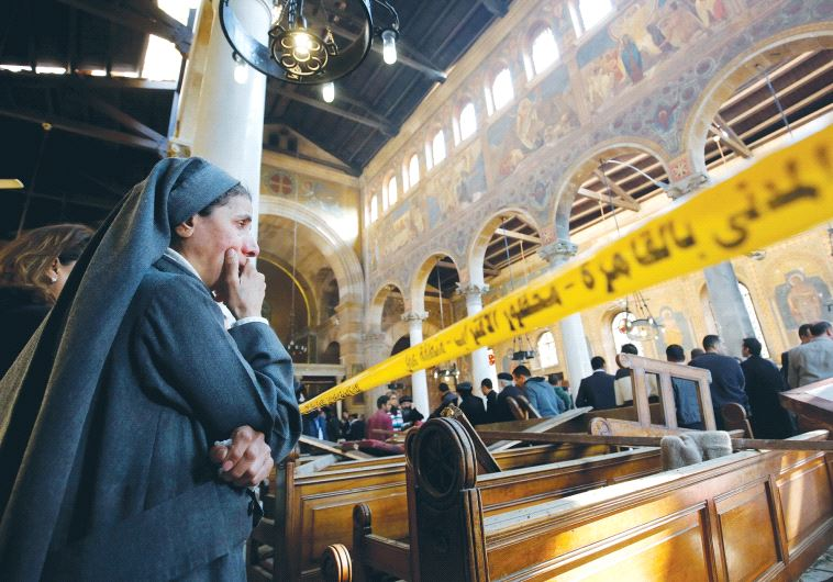 A NUN WEEPS inside Cairo's St. Marks Coptic Cathedral yesterday, after terrorists killed at least 25