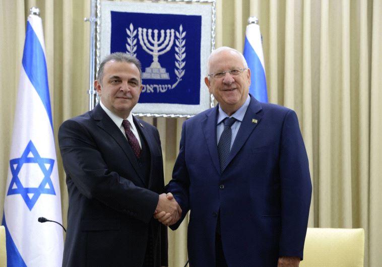 Kemal Okem, new Turkish ambassador to Israel, shakes Israeli president's hand