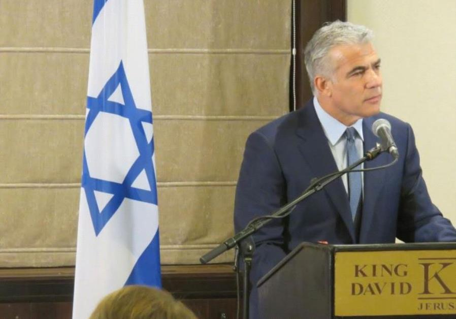 Yair Lapid at a meeting with the Foreign Press Association at Jerusalem's King David Hotel.