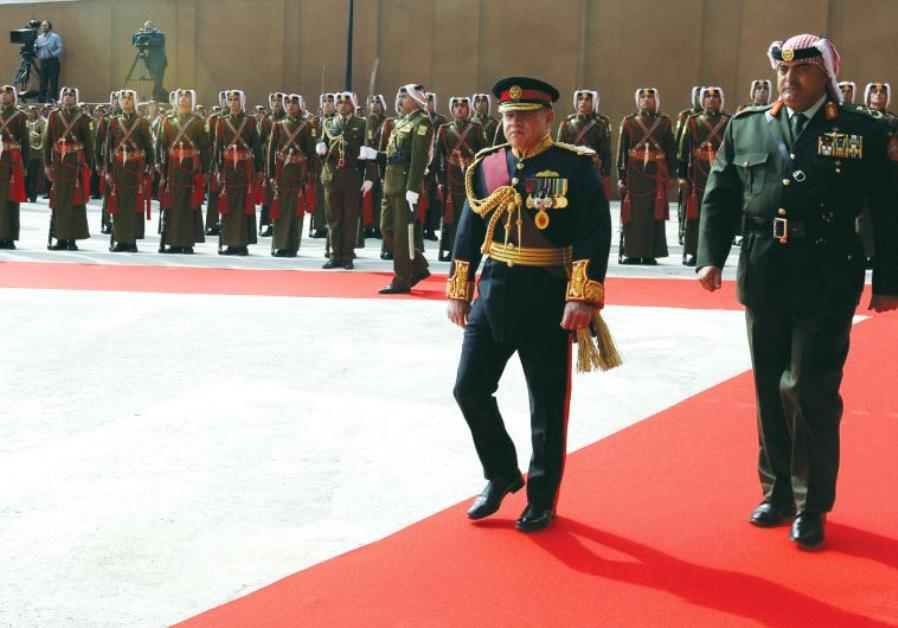 KING ABDULLAH reviews the honor guard during the opening ceremony of the first ordinary session of 1