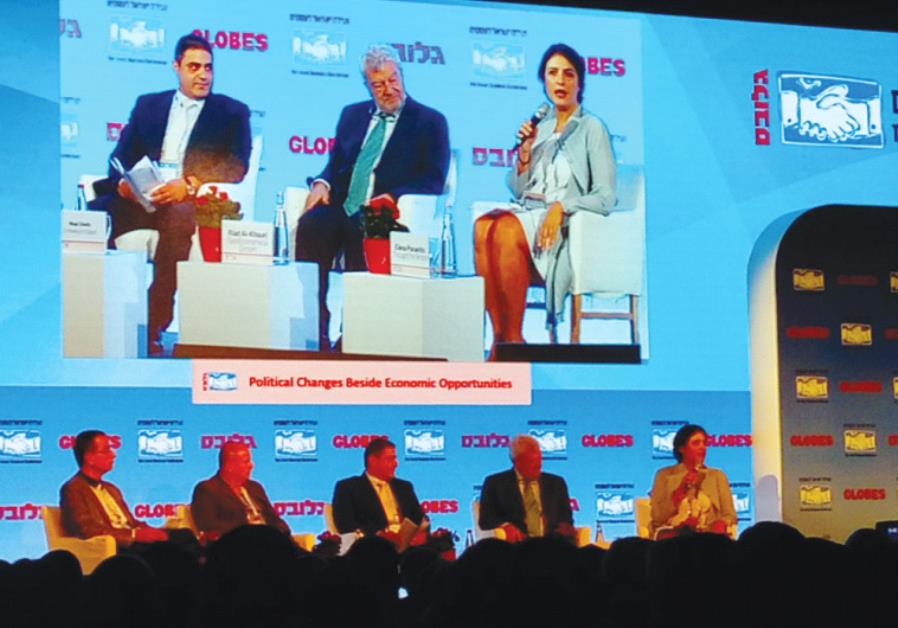 PANELISTS at yesterday's Globes Israel Business conference in Tel Aviv listen to a presentation.