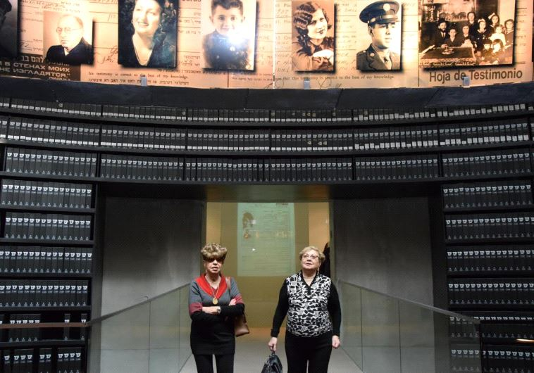Rywka Borenstein Patchnik and Fania Band Blakay walking arm-in-arm in Yad Vashem's Hall of Names