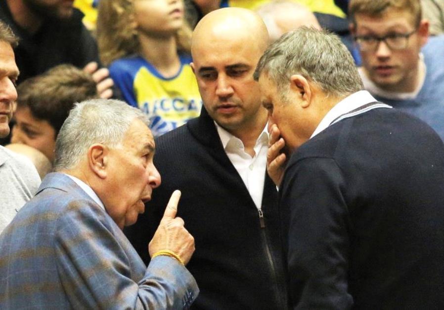 Maccabi Tel Aviv owners Shimon Mizrahi (left) and David Federman (right) and club CEO Hagay Badash (