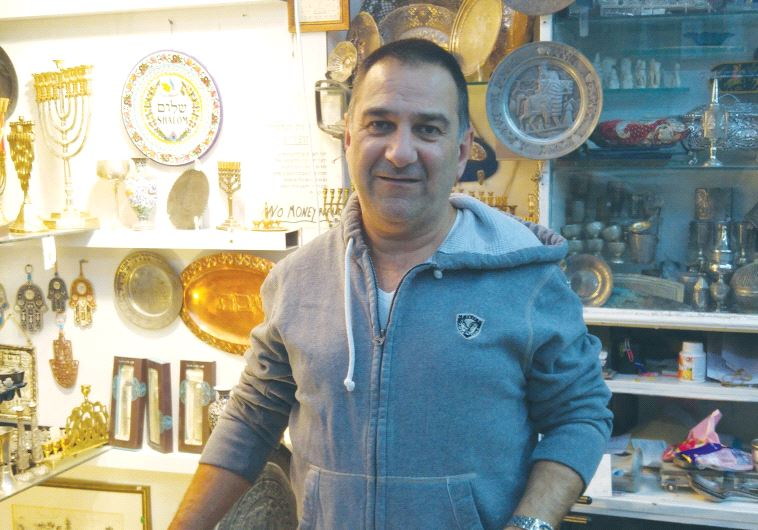 SHMUEL GHATAN, a Jerusalem store owner, says he would like to see the US Embassy moved to the capita