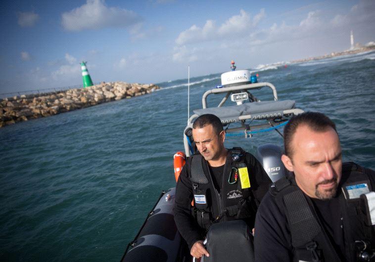 Erman Skyman, (R) the Superintendent of the Tel Aviv police coastal patrol unit and Shlomo Maman, 44