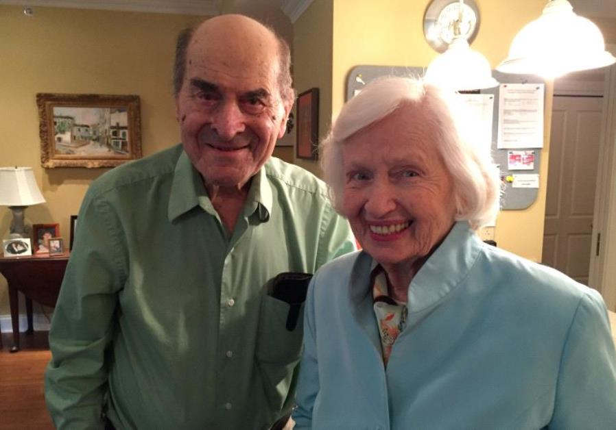 Dr. Henry Heimlich (L), the 96-year-old Cincinnati surgeon credited with inventing the life-saving t