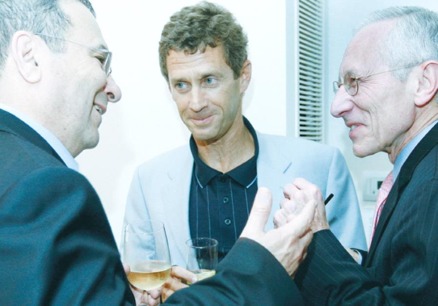 BUSINESSMAN BENY STEINMETZ (center) shares a light moment with former defense minister Ehud Barak
