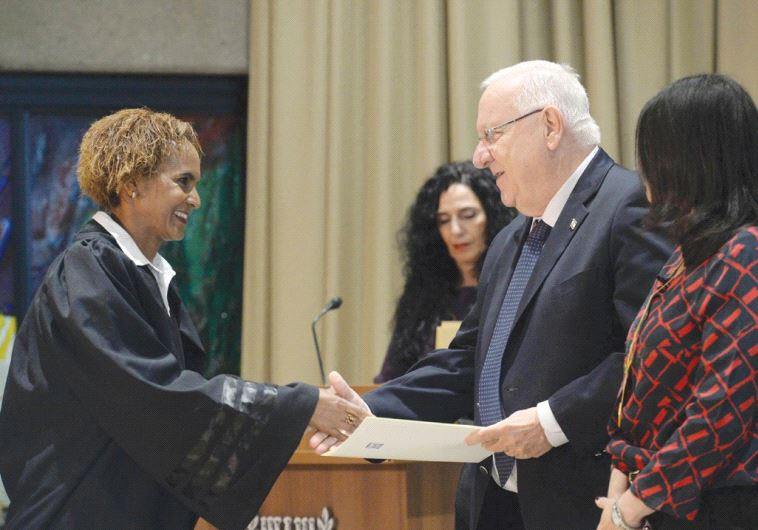 NEWLY APPOINTED Judge Ednaki Sebhat Haimowitz shakes hand with President Reuven Rivlin yesterday at