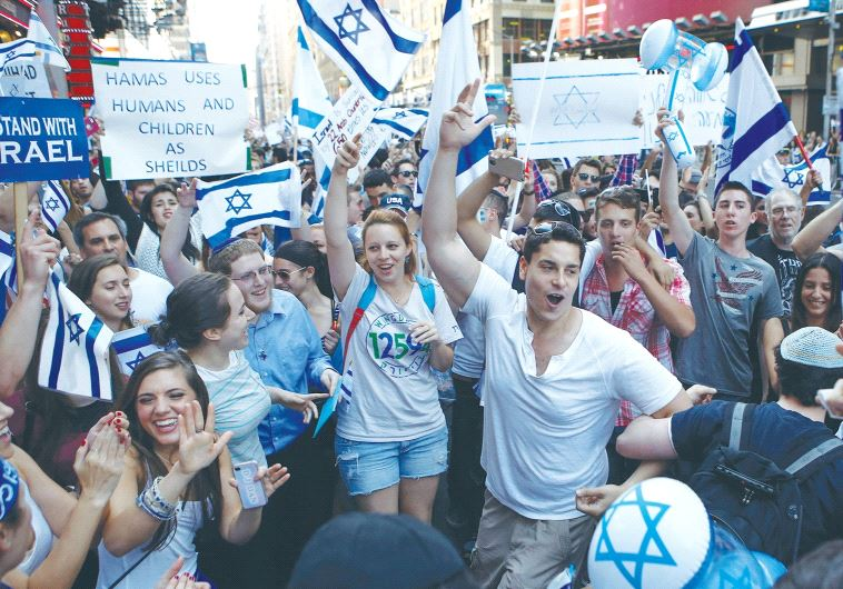 PRO-ISRAEL SUPPORTERS dance during a rally in New York's Times Square in 2014.