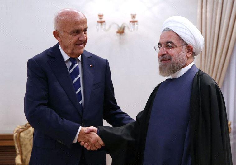 Iranian President Hassan Rouhani greeting Lebanese Defense Minister Samir Moqbel (L) at the presiden