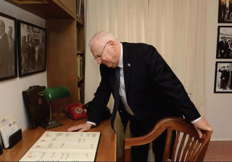 PRESIDENT REUVEN RIVLIN stands alongside prime minister Levi Eshkol's personal desk and chair. Note