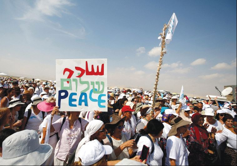 PRO-PEACE DEMONSTRATORS take part in a march in October. The author argues that Israel needs to conc
