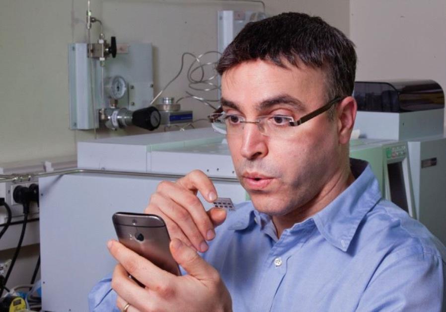 PROF. HOSSAM HAICK breathes on a sensor he developed that is capable of identifying various chronic