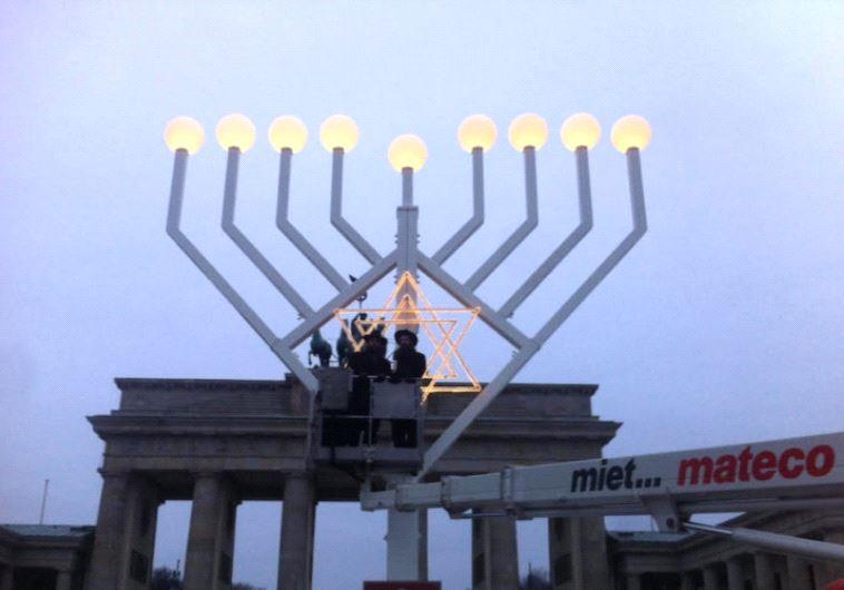 Rabbi Teichtel testing out menorah lighting in Berlin