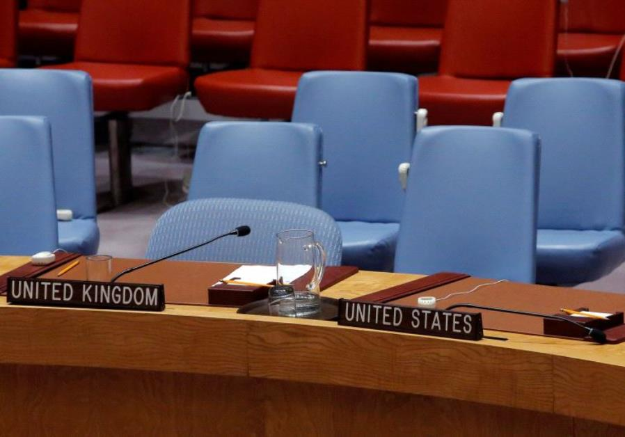 The seats of Britain and the United States sit empty in the United Nations Security Council chamber.