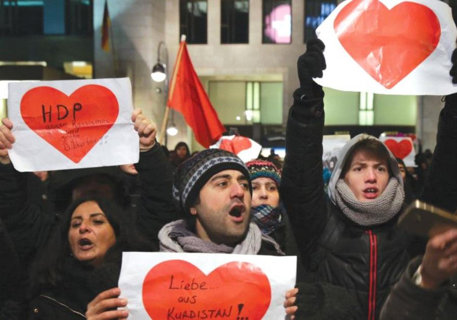 GERMANS WITH signs of love after the Christmas market terrorist attack in Berlin.