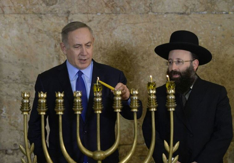 Prime Minister Benjamin Netanyahu Lighting Hanukkah candles at the Kotel