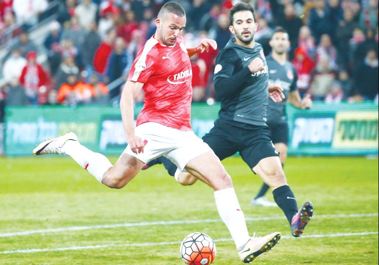 Hapoel Beersheba striker Ben Sahar (left) scored his team's equalizer last night, but the reigning c