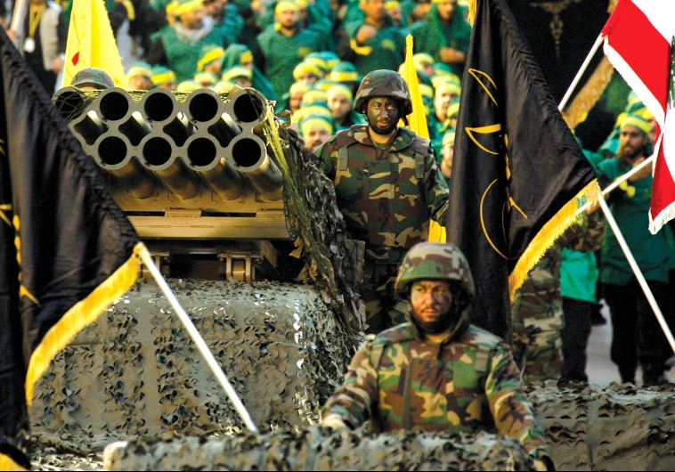 Hezbollah displays a pick-up truck mounted with a multiple rocket launcher in a parade in the southern Lebanese city of Nabatiyeh in 2014 (photo credit: MAHMOUD ZAYYAT / AFP)