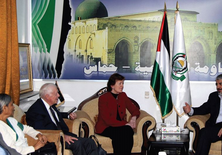 FORMER US President Jimmy Carter (third left) meets Hamas leader Khaled Mashaal (right) in Damascus